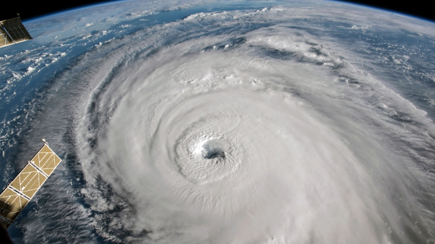 In this NASA handout image taken from aboard the International Space Station, shows Hurricane Florence as it travels west in the Atlantic Ocean off the coast of the U.S. on September 12, 2018.