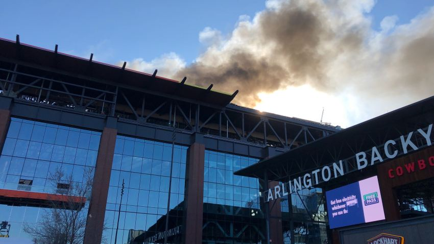 fire billowing from the roof of Globe Life Field in arlington