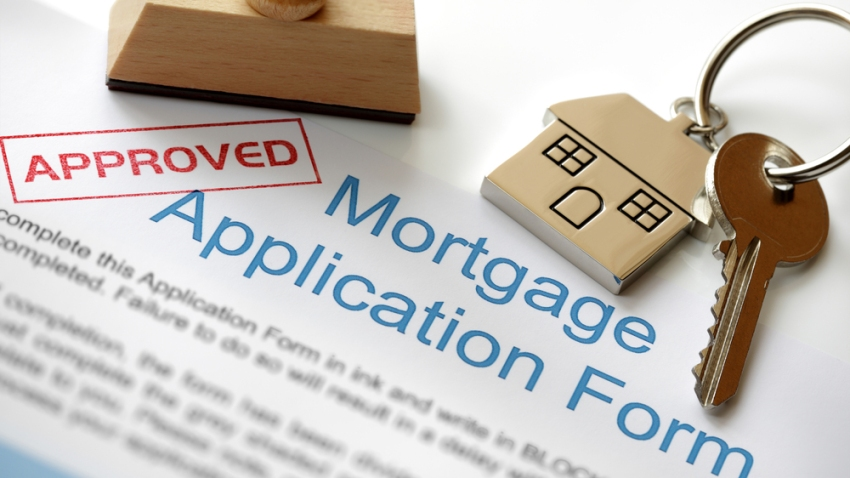 Formulario simulado de solicitud de préstamo hipotecario.