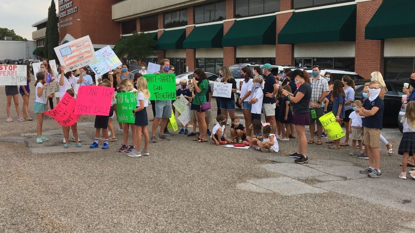 A group of Fort Worth ISD parents held a demonstration at the district's administration offices to ask for a decision on a start date for in-person classes.
