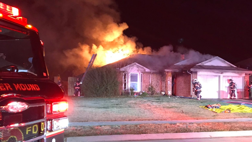 Firefighters in Flower Mound rescued a person trapped inside a bedroom of a burning home early Thursday morning.