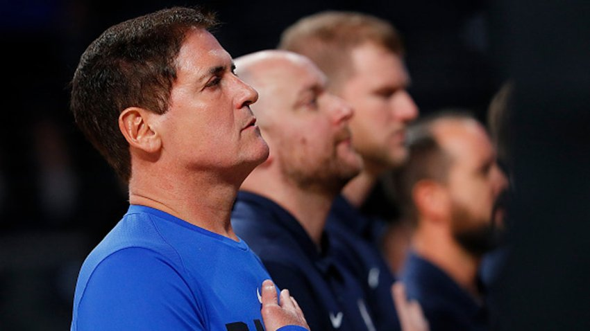 In this Oct. 12, 2017, file photo, Mark Cuban, owner of the Dallas Mavericks, stands during the National Anthem prior to the game against the Atlanta Hawks at McCamish Pavilion in Atlanta, Georgia.