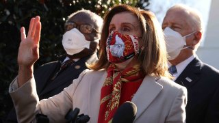 In this Feb. 5, 2021, file photo, Speaker of the House Nancy Pelosi (D-CA) (C) talks to reporters outside the West Wing after she and House Democratic leaders, Majority Whip James Clyburn (D-SC) (L) and Majority Leader Steny Hoyer (D-MD), met with U.S. President Joe Biden to discuss coronavirus relief legislation at the White House in Washington, D.C.
