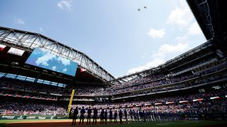 F-16 fighter jets perform a flyover during the National Anthem before the Texas Rangers take on the Toronto Blue Jays on Opening Day at Globe Life Field on April 5, 2021 in Arlington, Texas.