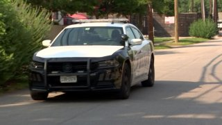 A Dallas officer was hospitalized and a second officer was injured during a traffic stop Wednesday afternoon in the 3000 block of Cotton Belt Avenue, police say.