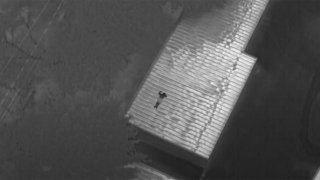 thermal picture of a man on a storage shed
